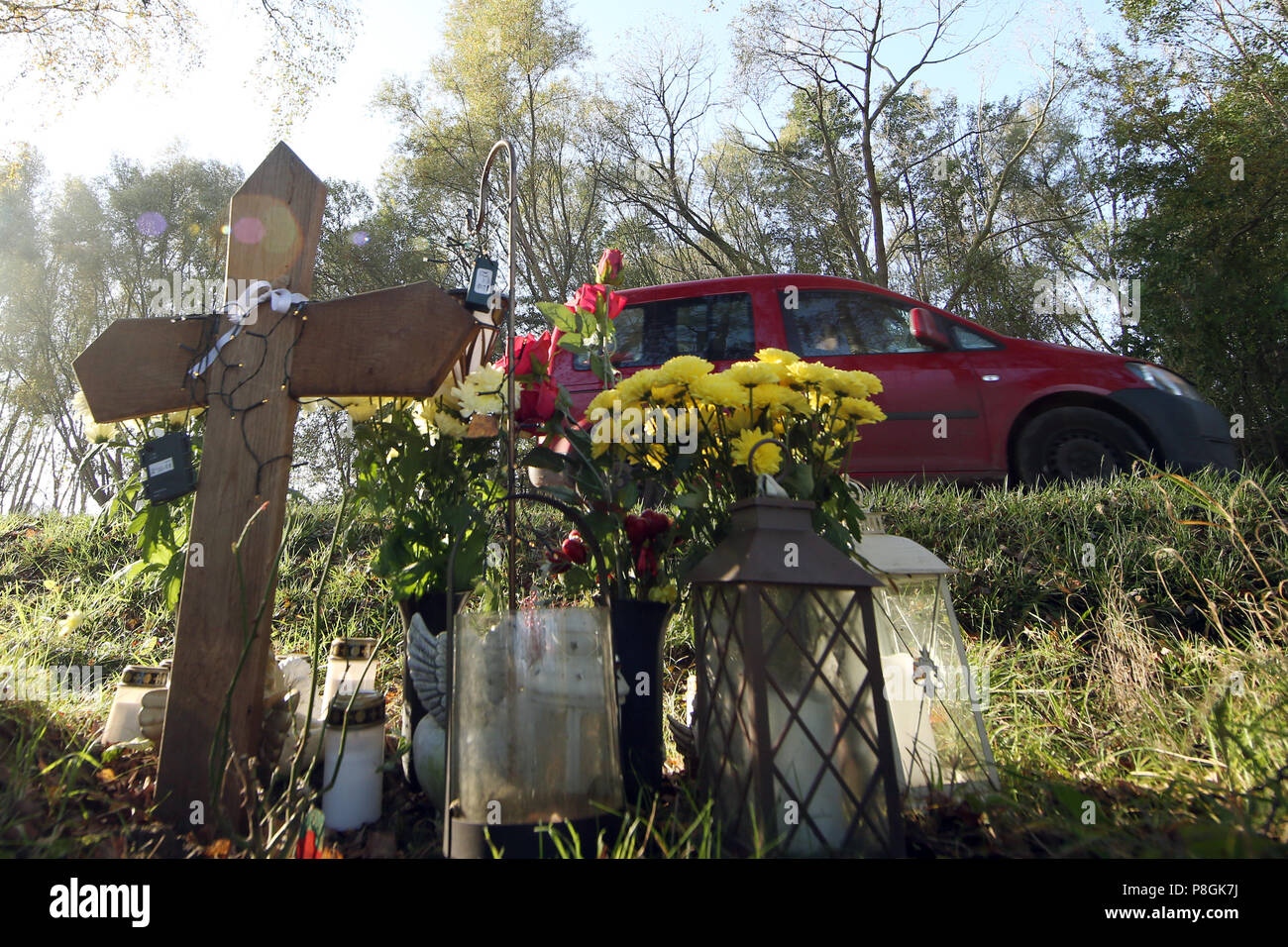 Goerlsdorf, Germany, memorial cross and flowers for a traffic victim on the roadside - Stock Image