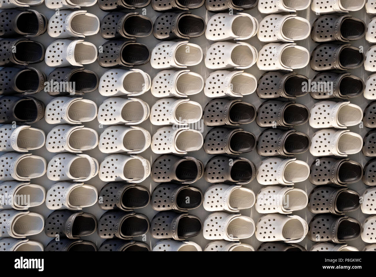 An abstract display of miniature Crocs at the entrance to the Croc Store on West 34th Street in Manhattan, New York City. - Stock Image