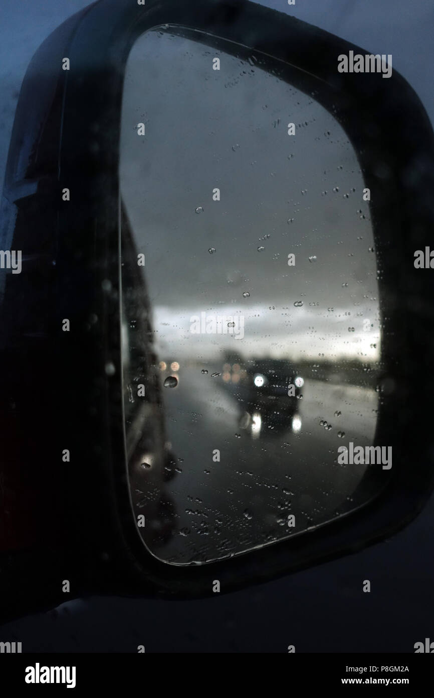 Hannover, Germany, poor visibility in the right side mirror of a car - Stock Image