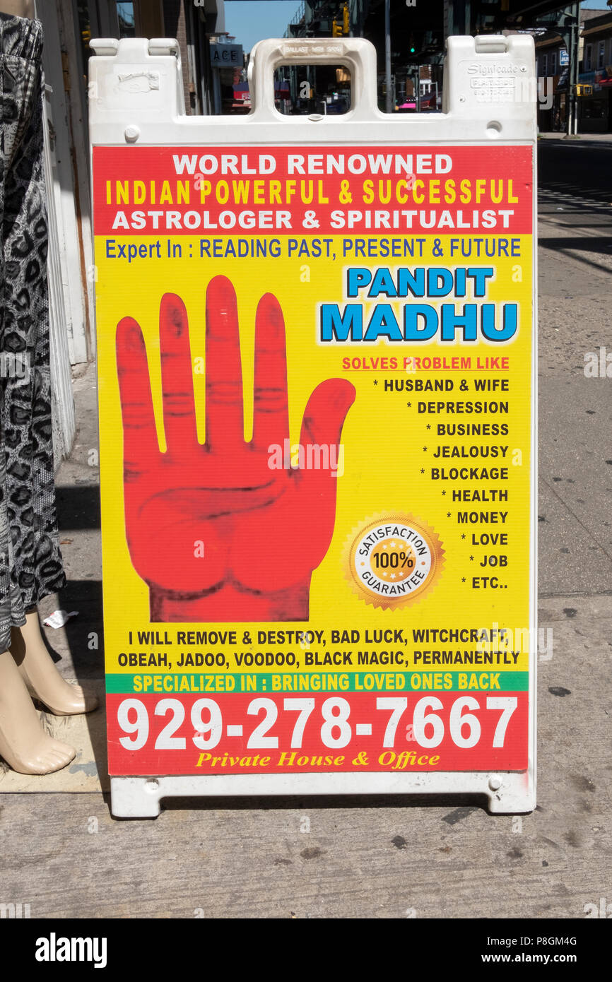 A sign advertisement for astrologer & spiritualist Pandit Madhu. On LIberty Ave. in Richmond Hill, Queens, New York - Stock Image