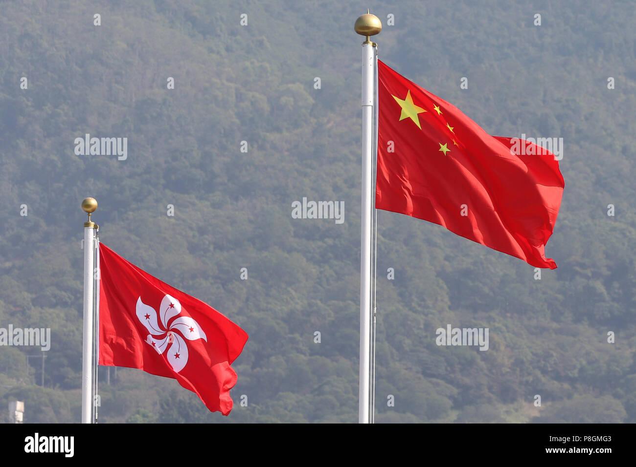 Hong Kong, China, National Flag of the People's Republic of China and Country Flag of Hong Kong - Stock Image
