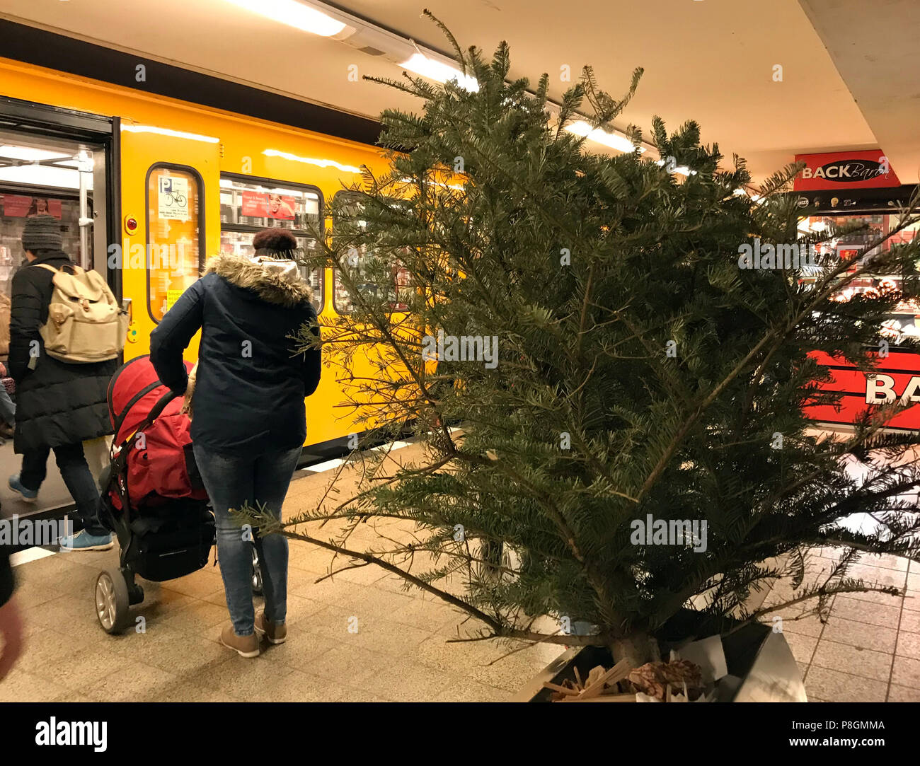 Berlin, Germany, Christmas tree is in a trash can on a subway station - Stock Image