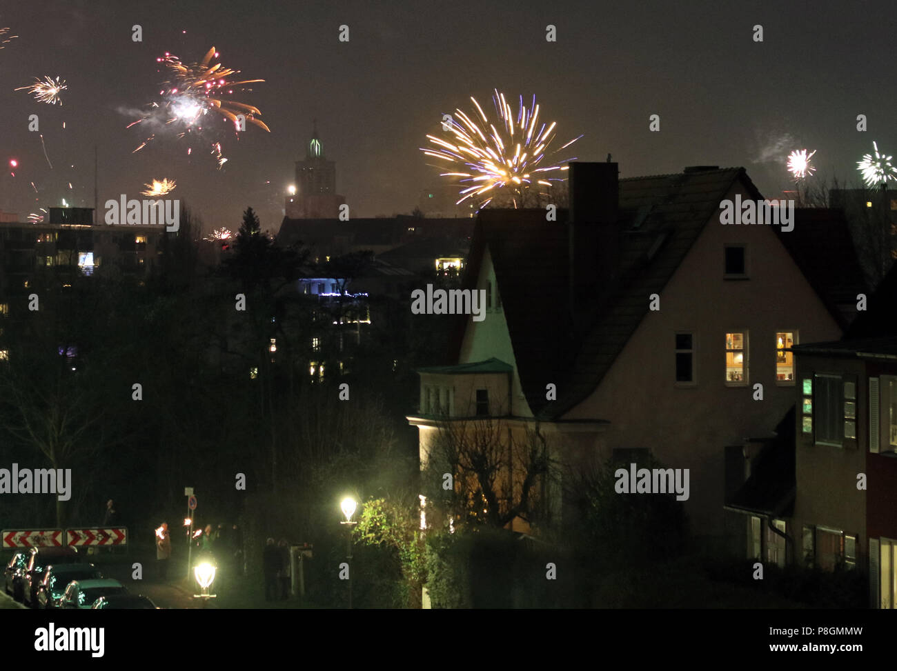 Berlin, Germany, New Year's Eve fireworks over a residential area Stock Photo