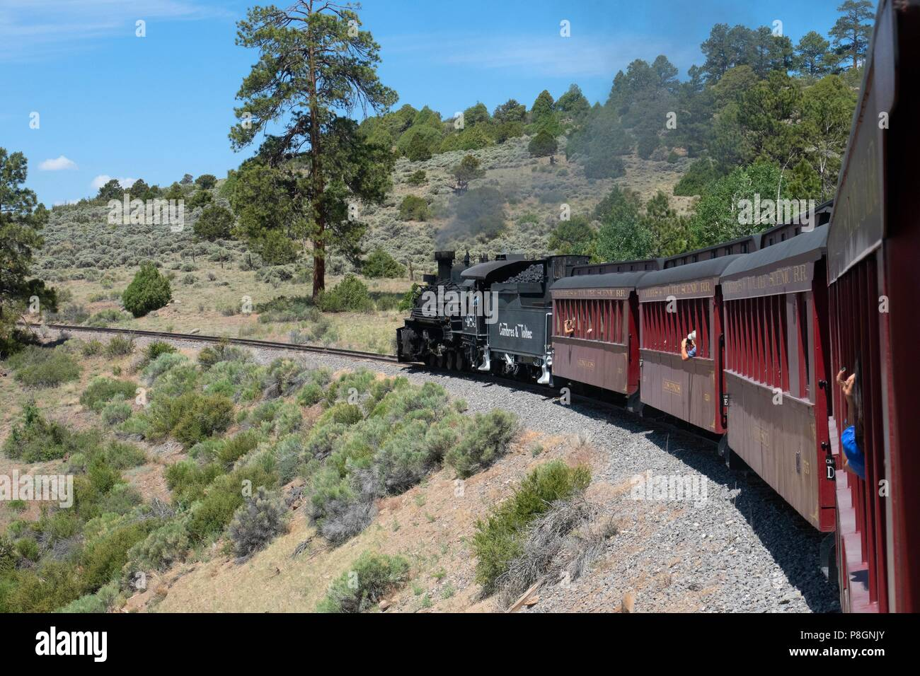 Restored steam engine 489 on the Cumbres and Toltec scenic narrow guage railway when the train load of tours through the inspiring scenery in New Mexi - Stock Image