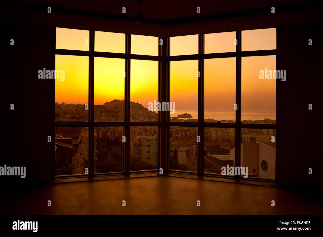 Sunset windows, most beautiful golden light Kuşadası through windows - Stock Image