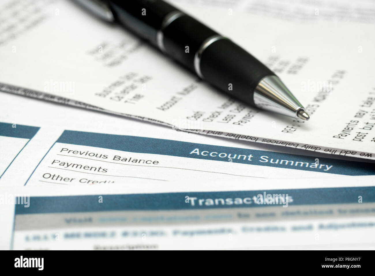 Pen On Top Of Receipts And Bank Statements - Stock Image
