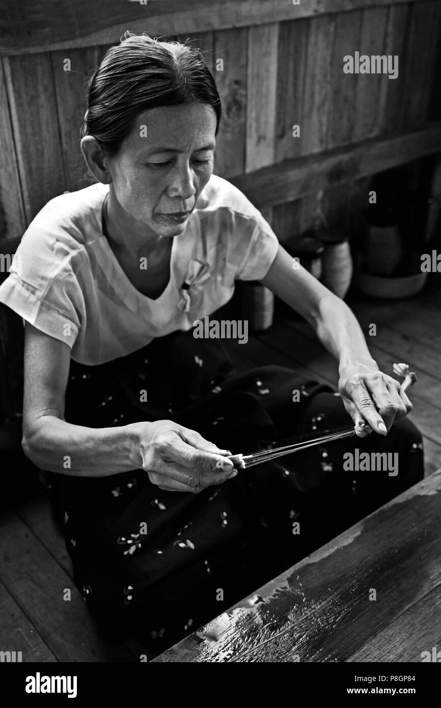 The making of LOTUS SILK from the stalks of the lotus plant is a local industry of INLE LAKE - MYANMAR - Stock Image