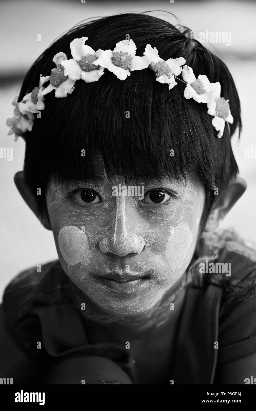A BURMESE GIRL with skin lightening cream on the Island of INWA which served as the Burmese Kingdoms capitol for 400 years - MYANMAR - Stock Image