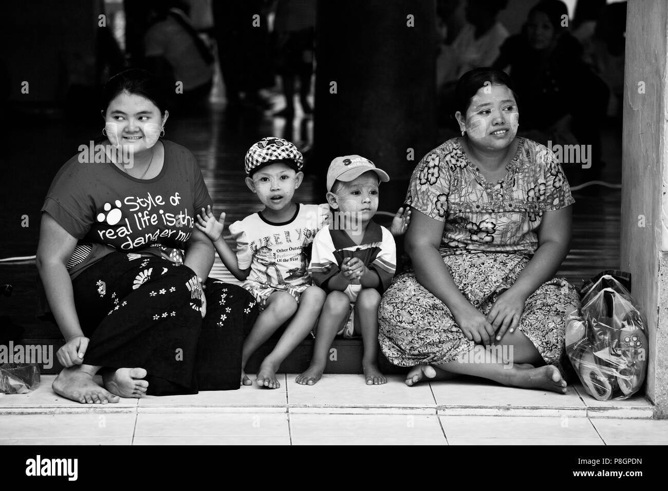 BURMESE WOMEN with their sons at the SHWEDAGON PAYA or PAGODA which dates from 1485 - YANGON, MYANAMAR Stock Photo