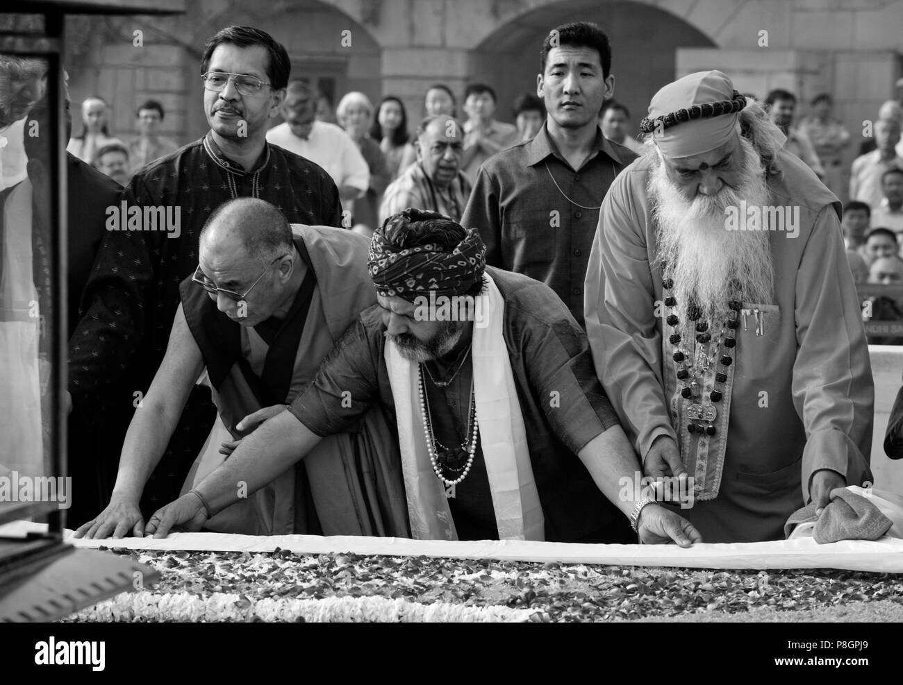Religious leaders participate in a PRAYER FOR WORLD PEACE sponsored by the14th Dalai Lama of Tibet at the RAJ GHAT (Ghandi's eternal flame) in April o - Stock Image