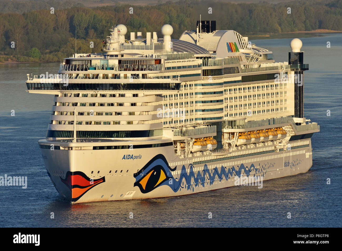 AIDAperla arrives in Hamburg in the early morning Stock Photo
