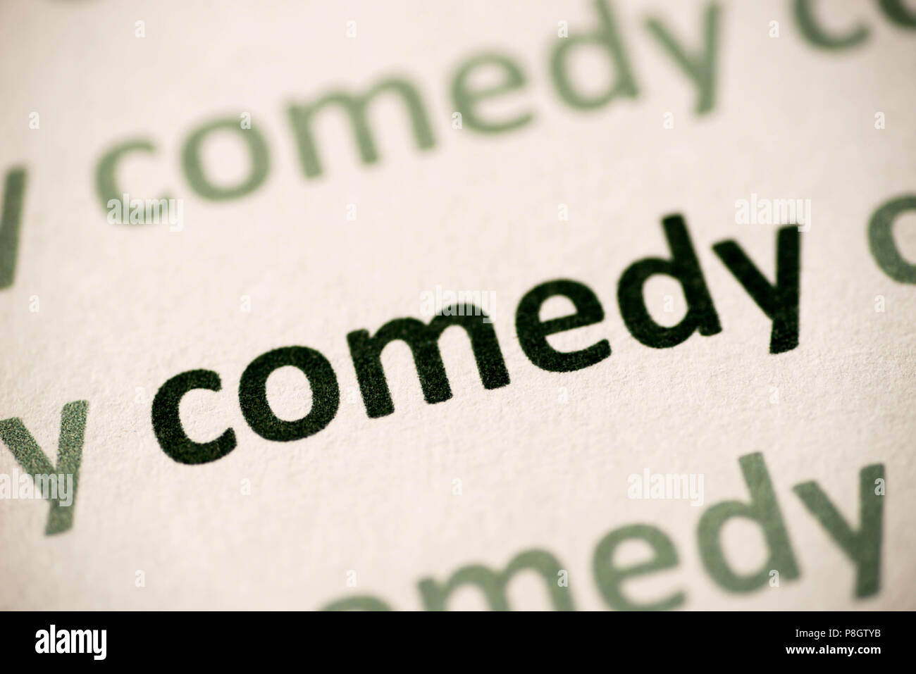 word comedy  printed on white paper macro - Stock Image
