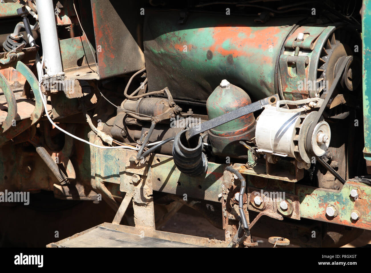 Old tractor engine with many modifications  Rusty, but