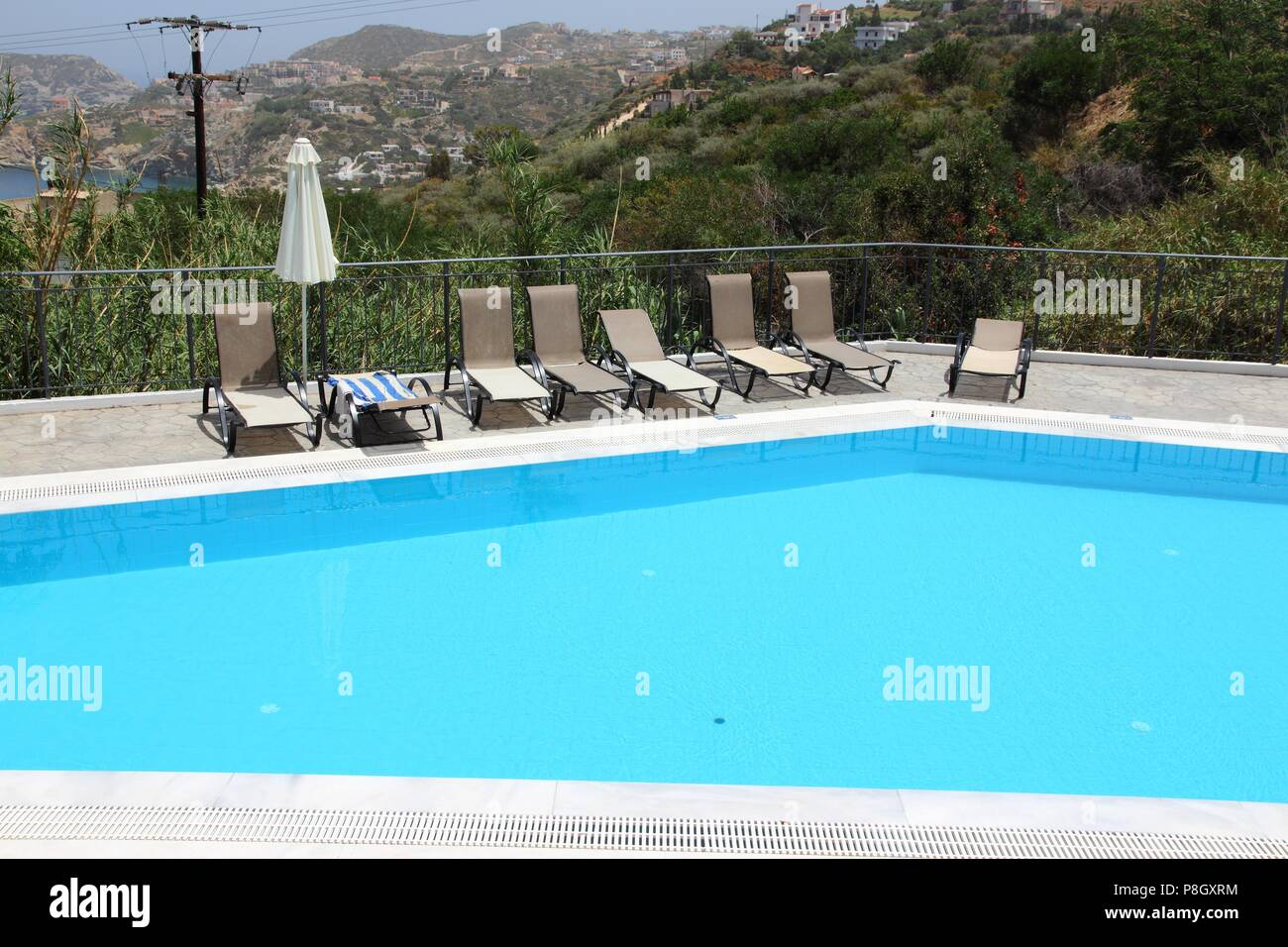 Superieur Generic Vacation Resort In Crete Island In Greece. Swimming Pool Sun Tanning  Chairs.