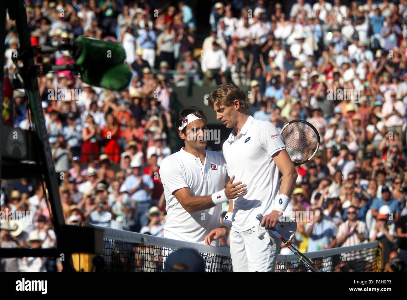 London, UK. 11th July, 2018.  Wimbledon Tennis:Roger Federer is consoled by opponent Kevin Anderson of South Africa after Anderson's five set victory over Federe in the quarter finals at Wimbledon today. Credit: Adam Stoltman/Alamy Live News - Stock Image