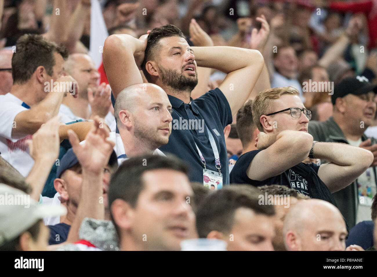 English fans are disappointed, disappointed, disappointed, disappointed, sad, frustrated, frustrated, hastate, half figure, half figure, fan, fans, spectators, supporters, supporters, Croatia (CRO) - England (ENG) 2: 1, semi-finals, Game 62, on 11.07.2018 in Moscow; Football World Cup 2018 in Russia from 14.06. - 15.07.2018. | Usage worldwide Stock Photo
