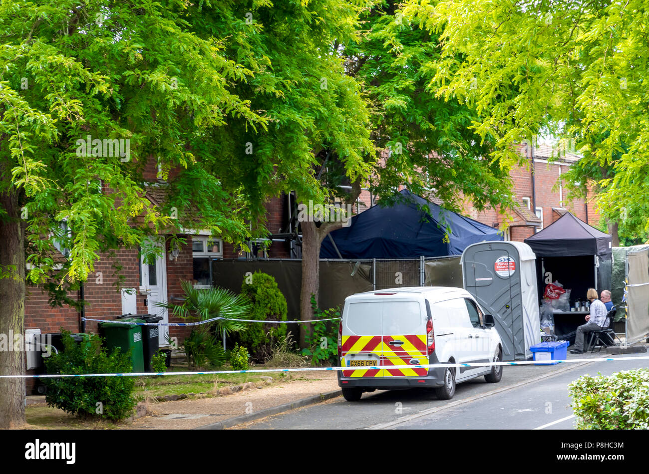 Croxden Way, Willingdon, Eastbourne, East Sussex, UK. 12th July 2018. Police have launched a murder investigation after the death of two people in a house fire in Eastbourne East Sussex. Officers and forensic experts remain at the scene of Tuesdays fatal fire. The fire in Croxden Way, Willingdon, Eastbourne started in the early hours of Tuesday morning. The victims have been named by police as Gina Ingles and her 4 year old son. Gina Ingles boyfriend Toby Jarrett survived the fire but remains in hospital in an induced coma with burns. Credit: Newspics UK South/Alamy Live News - Stock Image