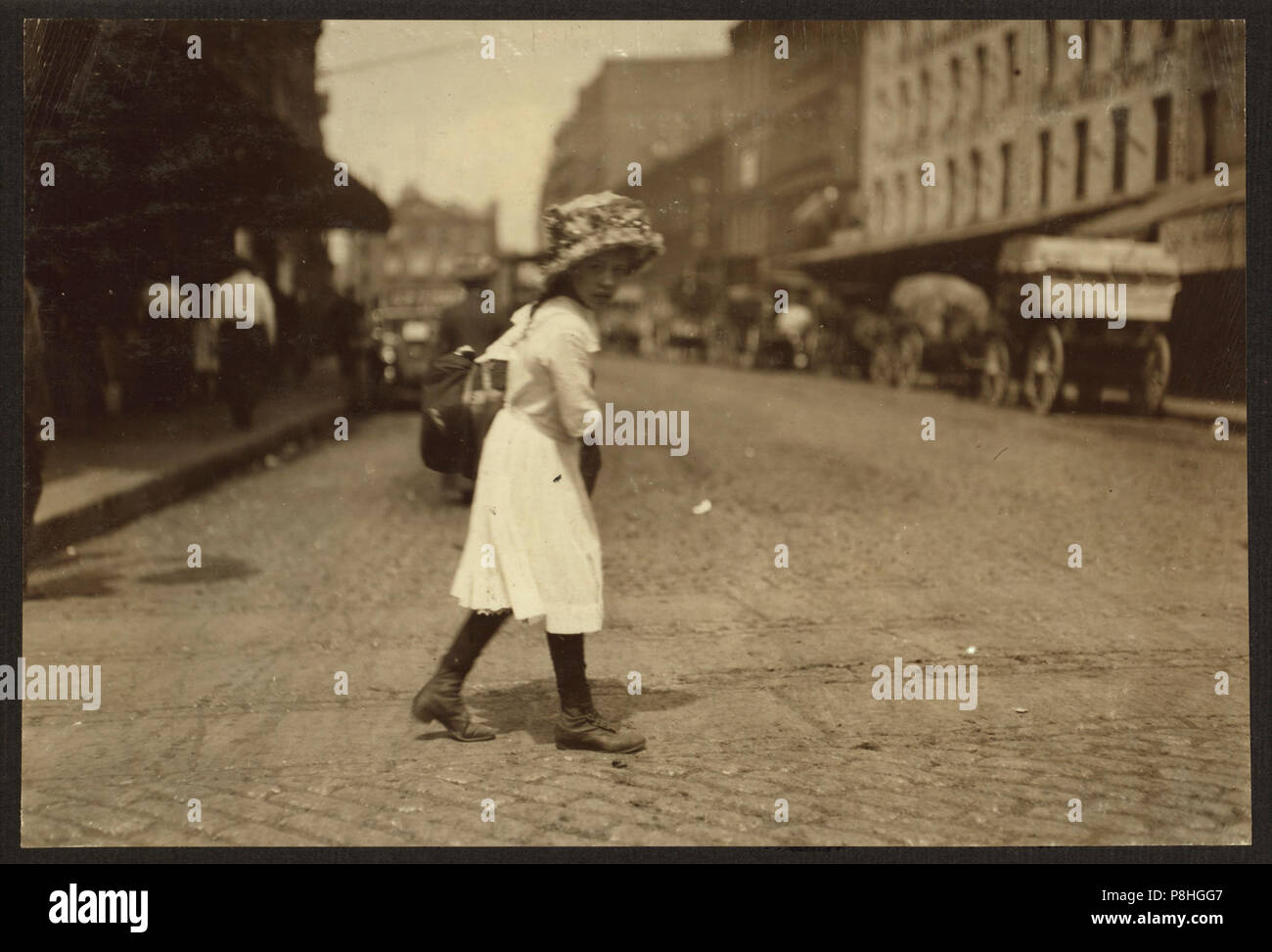 9 Year Old Girl Carrying Garments Down Blackstone Street Boston M To A Hanover Street Home She Finishes 8 Pairs Of Trousers A Day And Gets 8 Cents A
