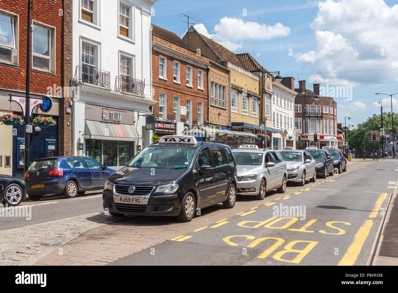 High Wycombe, UK - 3rd June 2018: Taxi cabs lines up at a taxi rank on High street. The official rank is where taxis are allowed to wait for passenger - Stock Image