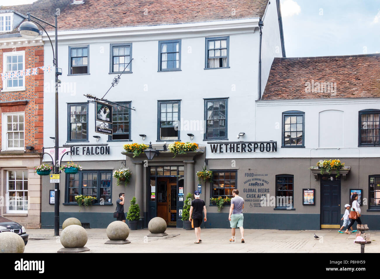 High Wycombe, UK - 3rd June 2018: People approaching the Falcon pub. The pub belongs to the Wetherspoon chain. - Stock Image