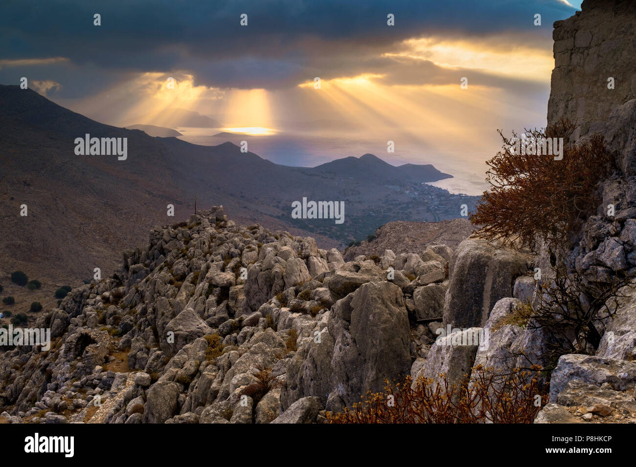 Sun rays over the bay seen from the medieval castle of Halki. - Stock Image