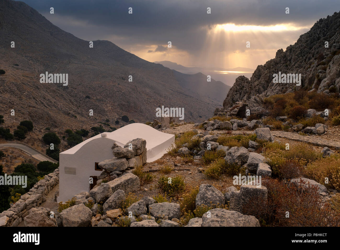 A small white chapel on the hill beneath the castle on Halki. - Stock Image