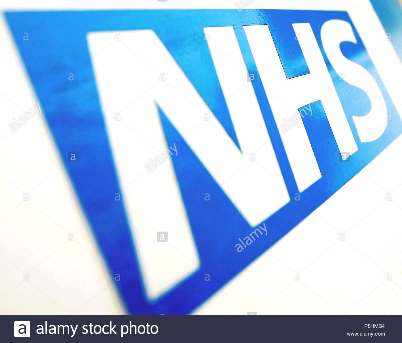 """File photo dated 07/12/10 of the NHS logo. The National Health Service (NHS) is """"stubbornly attached"""" to fax machines, the Royal College of Surgeons (RCS) has said, as figures reveal there are thousands on sites across the country. - Stock Image"""
