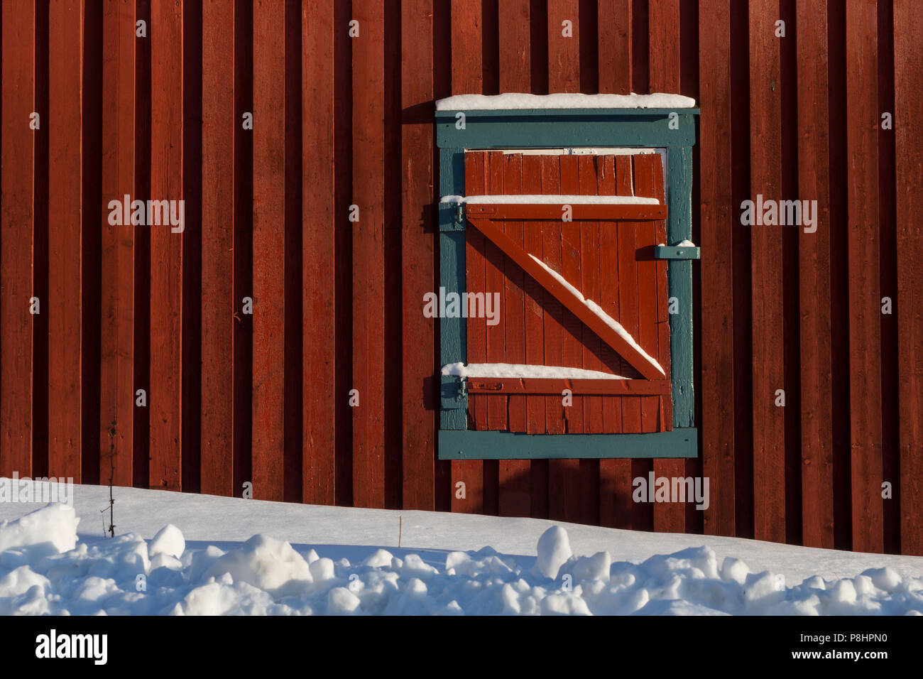 red window blinds red black closed window blinds of red wooden cabin in winter snow zshaped texture