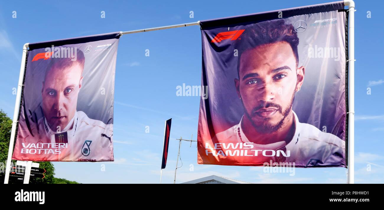 Lewis Hamilton and Valtteri Bottas images on flags, Silverstone circuit, Northampton, British Grand Prix 2018, England, UK Stock Photo
