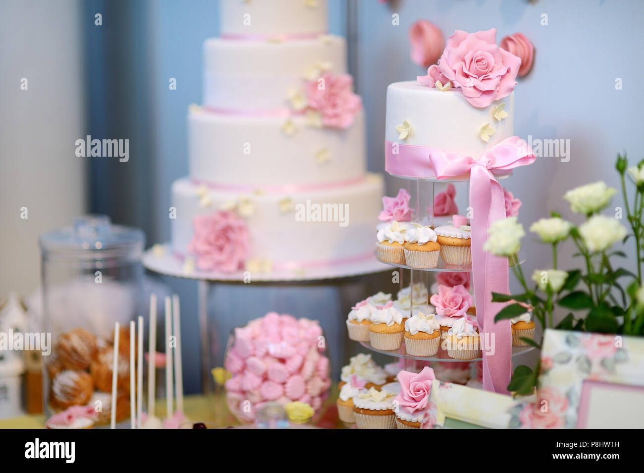 White Wedding Cupcake Cake Decorated With Pink Flowers Stock Photo