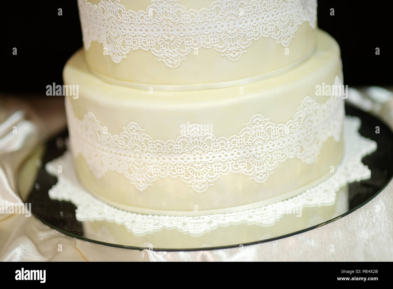 White Wedding Cake Decorated With White Lace And Flowers Stock Photo