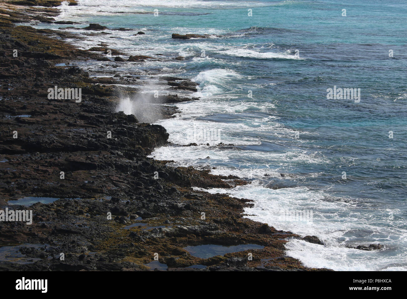 Volcanic rock shoreline as viewed from the Halona Hole Lookout. Oahu Island, Hawaii, USA. - Stock Image