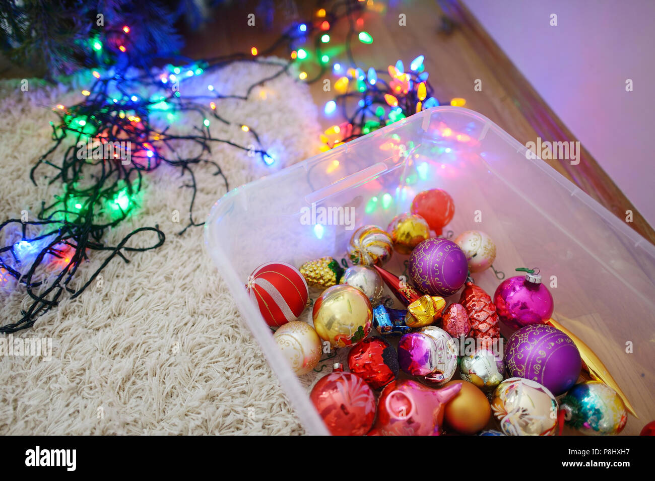 various colorful christmas decorations in a box