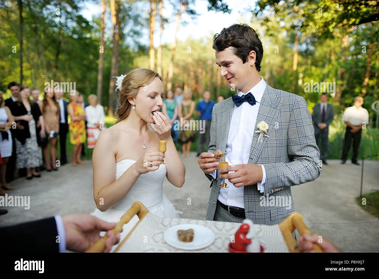 Bride and groom being met by parents with bread and water - Stock Image
