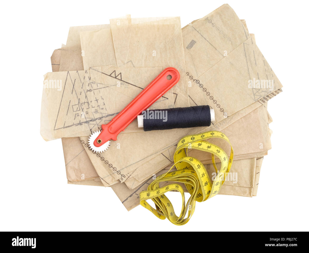 Dressmaking, sewing equipment isolated on white. Paper pattern thread, marker etc. - Stock Image