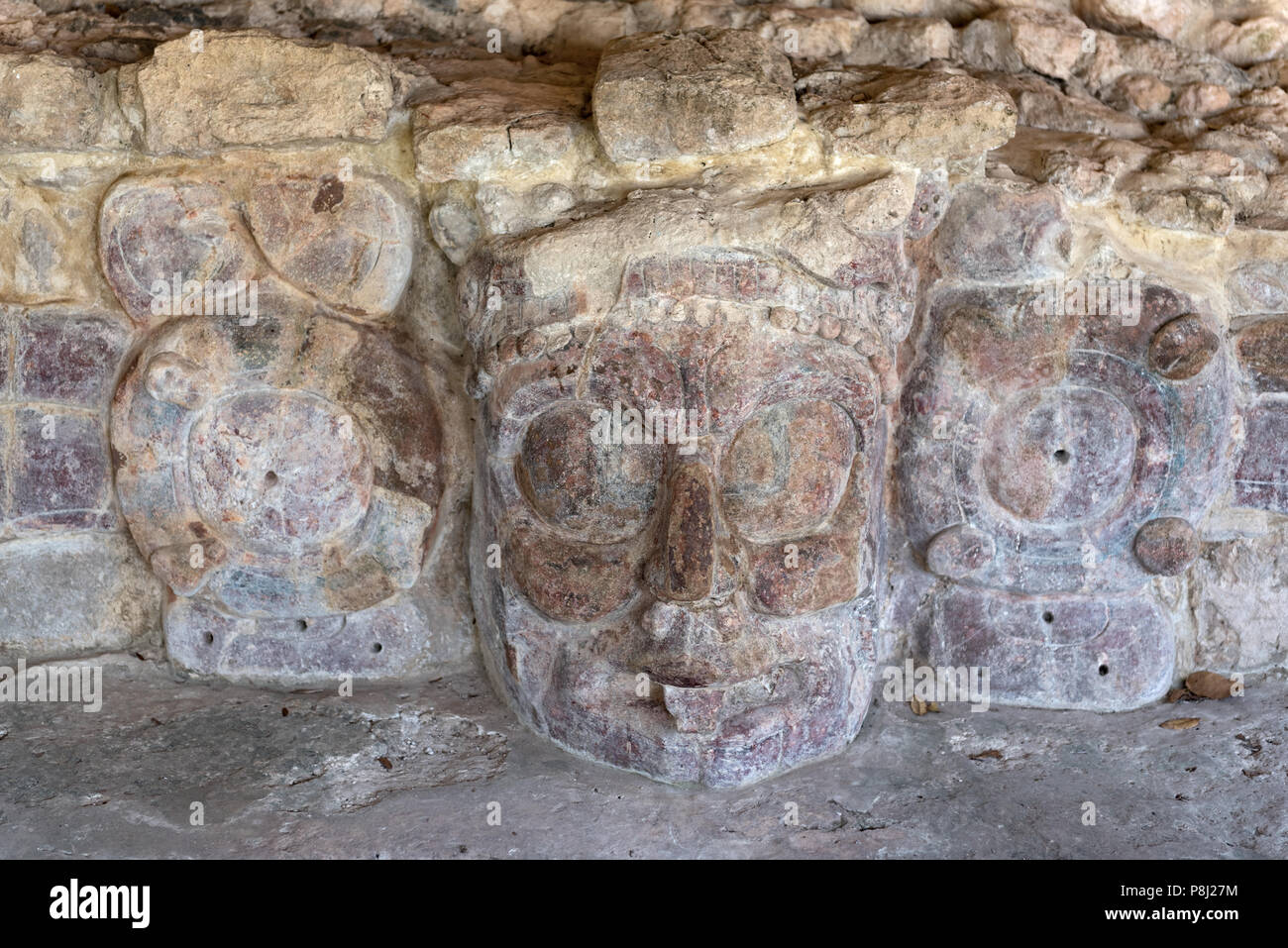 Stone mask at Maya archeological site Edzna, Mexico. - Stock Image