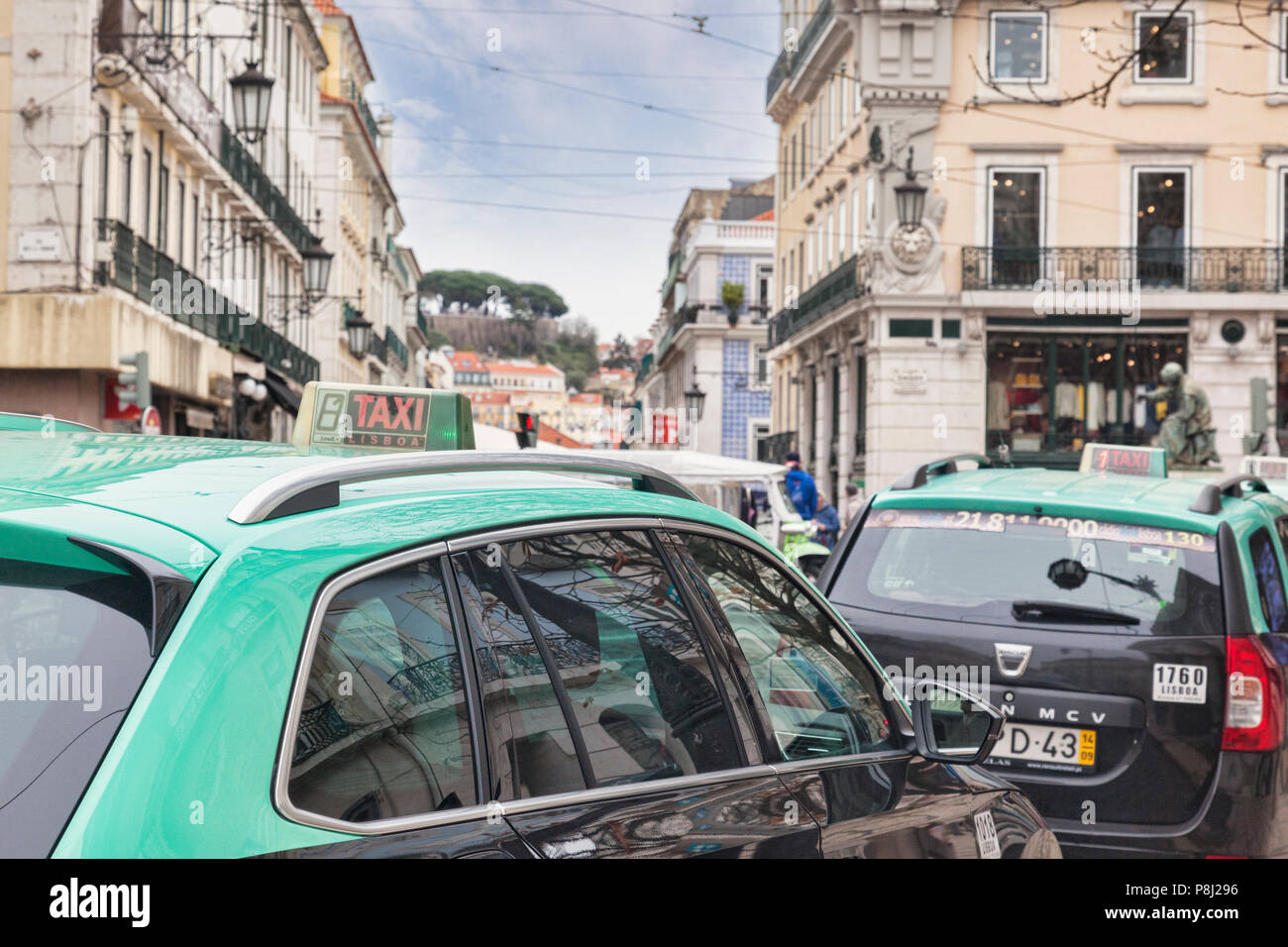 7 March 2018: Lisbon, Portugal - Taxi cabs bumper to bumper in the central city. Focus on foreground. - Stock Image