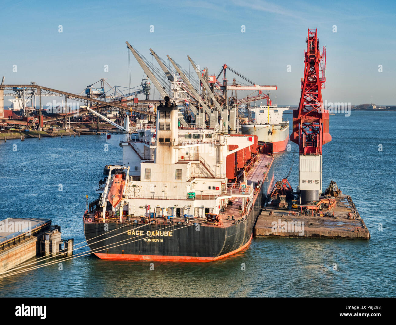 6 April 2018: Rotterdam, Netherlands - Sage Danube bulk carrier at Port of Rotterdam on a sunny spring morning with clear blue sky. - Stock Image