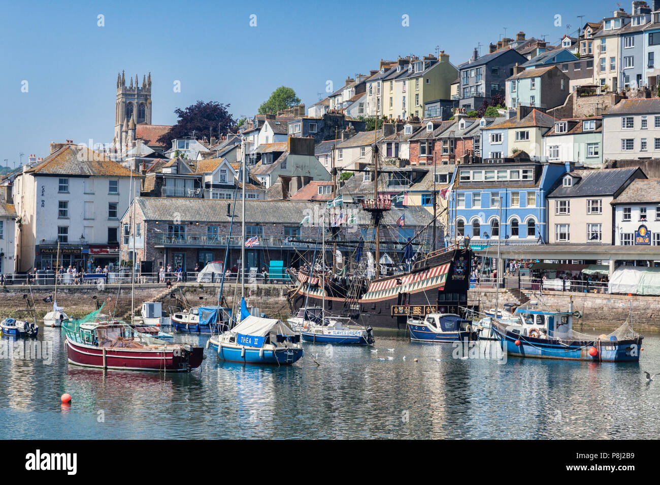 23 May 2018: Brixham, Devon, UK - The harbour with the replica Golden Hind on a fine spring day. - Stock Image