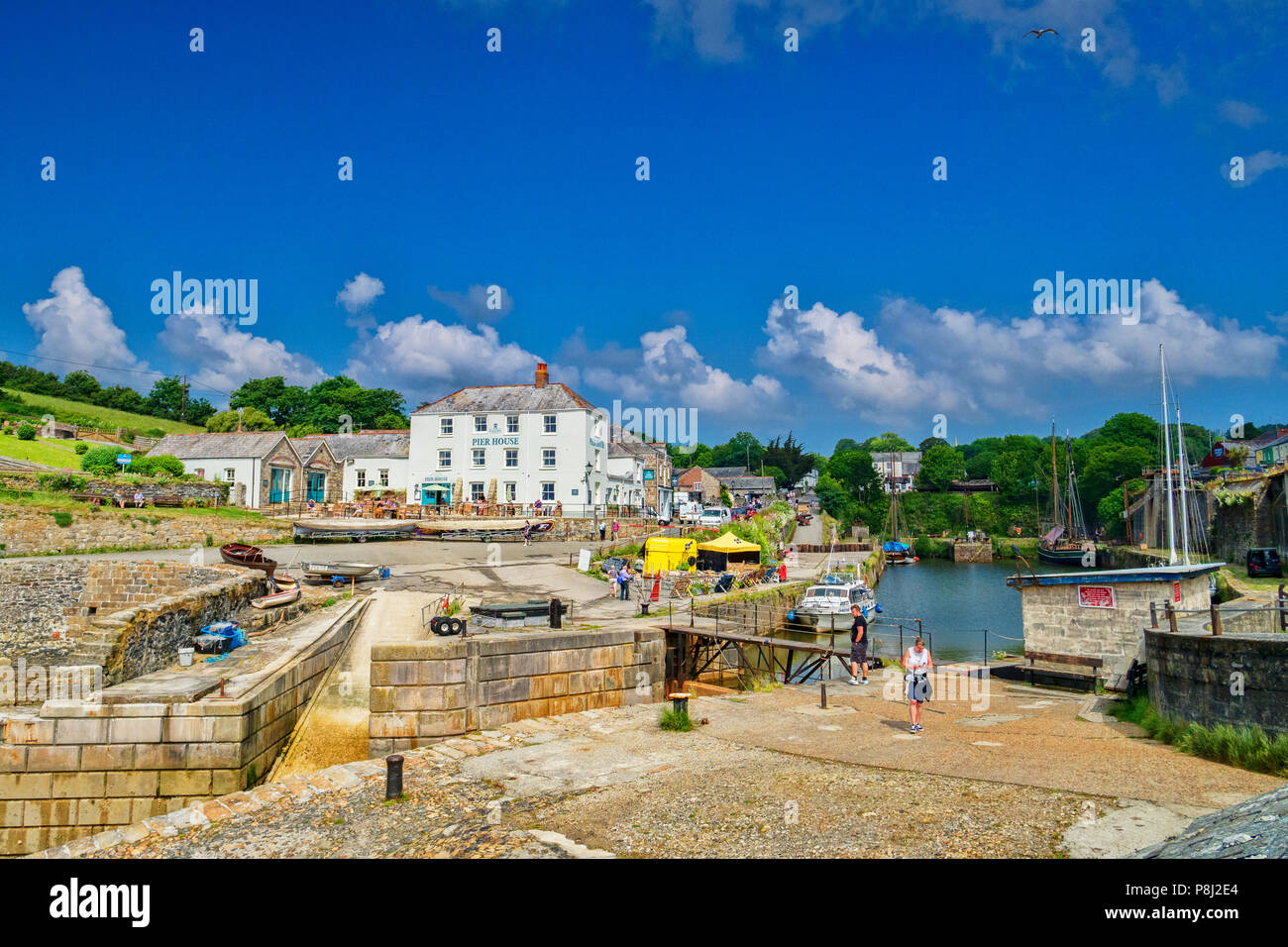 11 June 2018: Charlestown, Cornwall, UK - An unspoiled example of a Georgian working port, it was built betweel 1791 and 1801, and has been used as a  - Stock Image