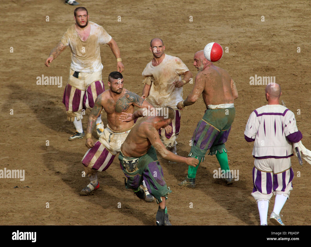 Calcio fiorentino, an early form of football that originated in 16th-century Italy, on the Piazza Santa Croce in Florence Italy.  Featuring: atmosphere Where: Florence, Tuscany, Italy When: 10 Jun 2018 Credit: IPA/WENN.com  **Only available for publication in UK, USA, Germany, Austria, Switzerland** Stock Photo