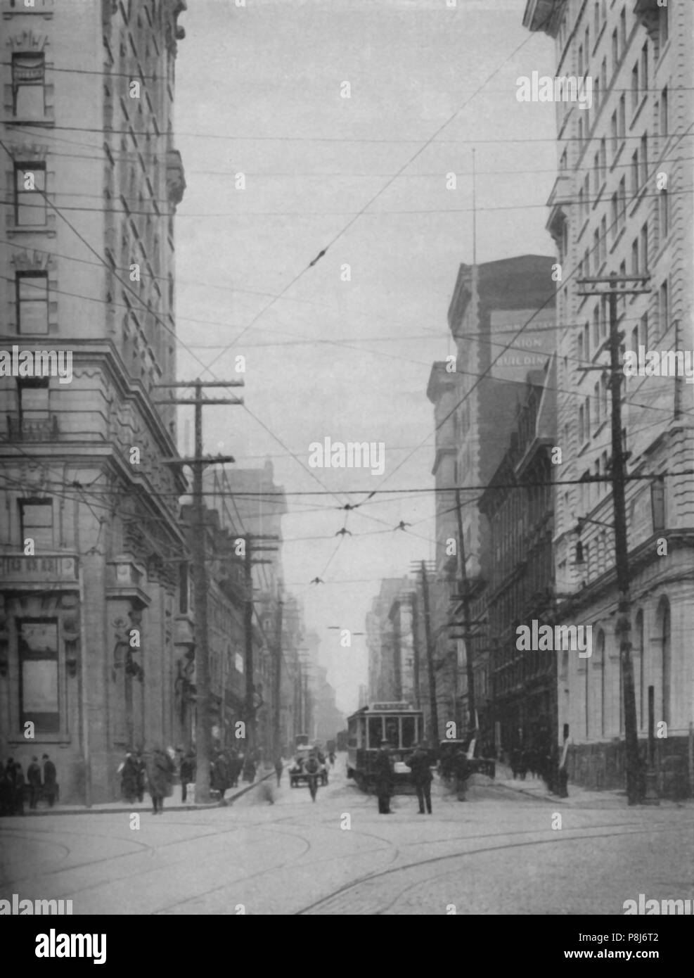 'Towering Facades of One of the City's Busiest Shopping Thoroughfares', c1935. Saint Jacques Street or St. James Street, Montreal, Canada. From Our Wo - Stock Image