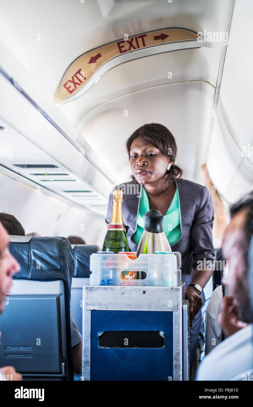 LUANDA/ANGOLA - 17MAY2018 - African hostess serving on the plane - Stock Image