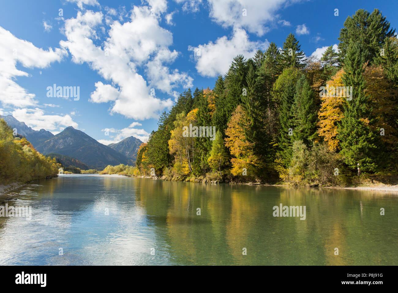 The river Lech with autumnal forest near the Ziegelwiesen, Füssen, Bavaria, Germany Stock Photo