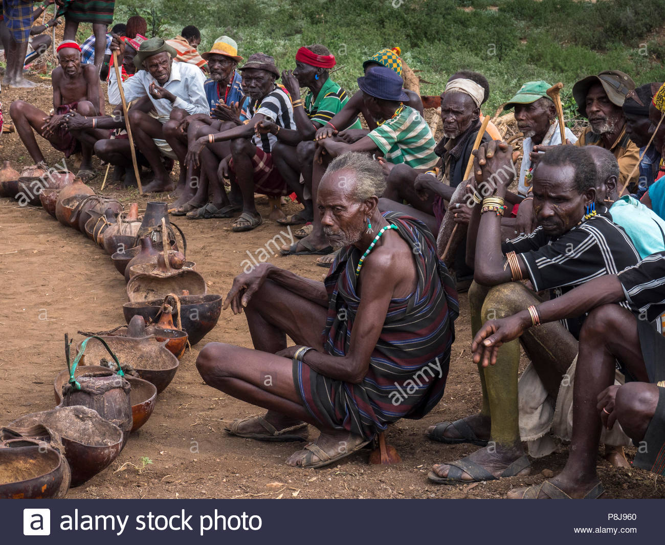Group of old men from the Hamar tribe, squatting in a circle, Omo region, Ethiopia - Stock Image