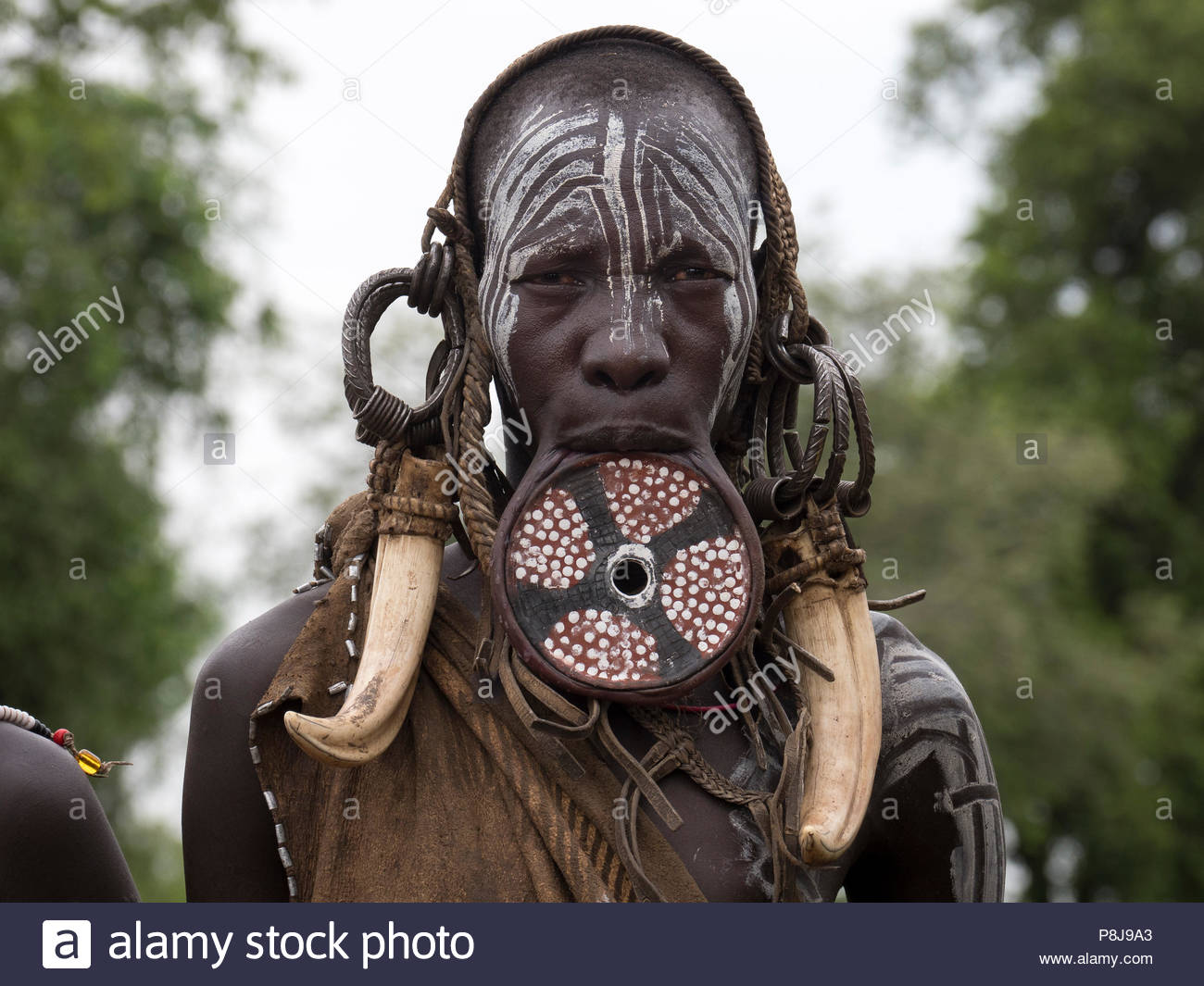 Woman with lip plate from the Mursi tribe, Ethiopia - Stock Image