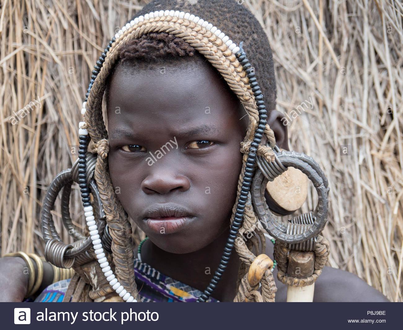 Mursi boy with headdress, portrait, Ethiopia - Stock Image