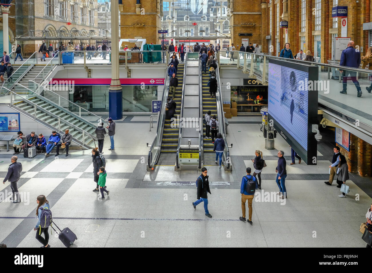 Liverpool Street, London, UK - April 6, 2018:People on the escalator near the entrance to Liverpool Street Mainline Station. - Stock Image