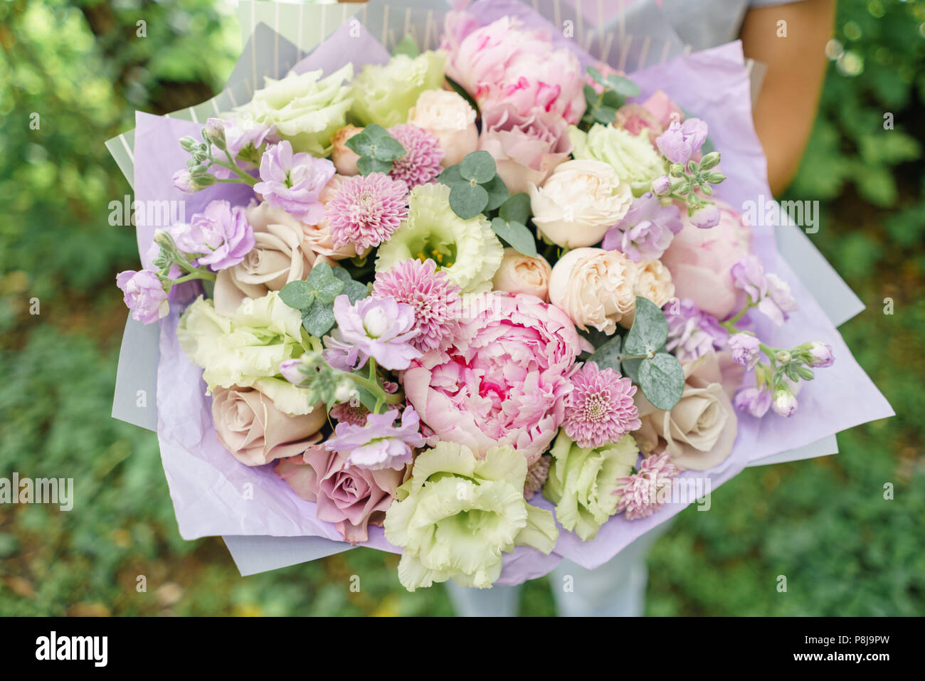 Beautiful summer bouquet arrangement with mix flowers young girl beautiful summer bouquet arrangement with mix flowers young girl holding a flower bunch with peony the concept of a flower shop content for the catalog izmirmasajfo