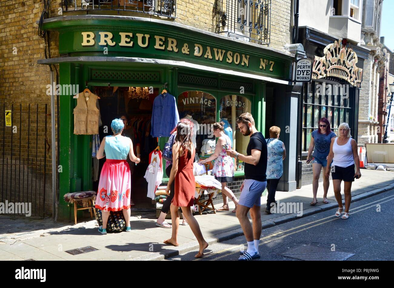 fashion clothes shoppers outside the breuer and dawson vintage clothes shop margate kent uk - Stock Image
